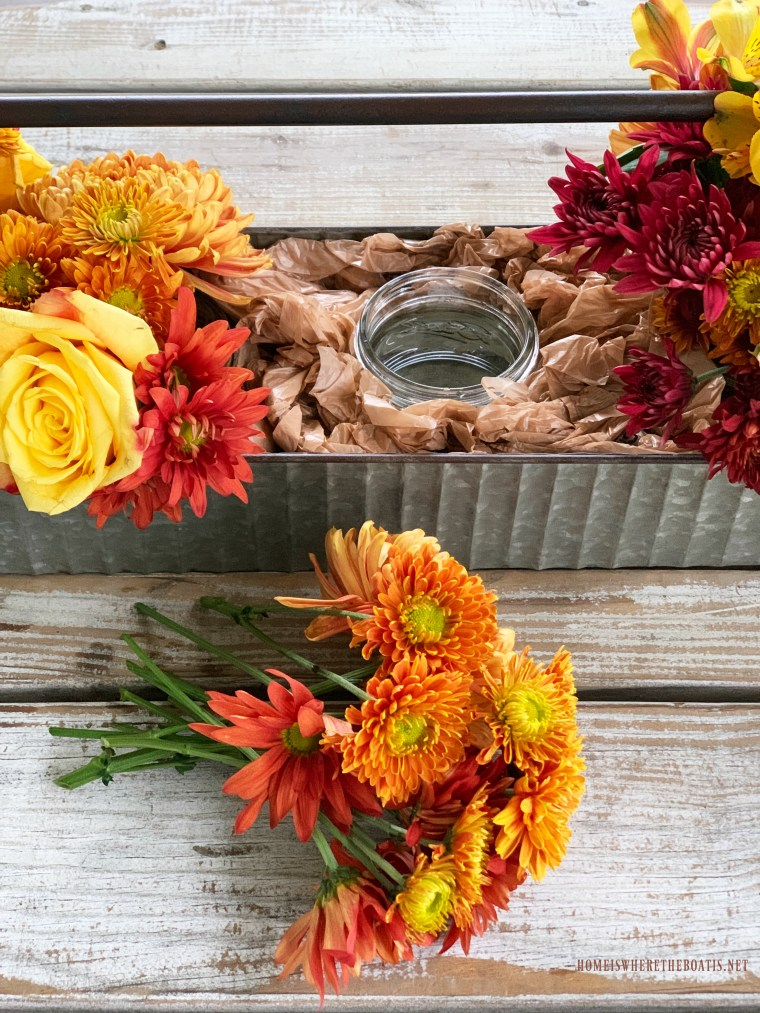 DIY fall floral centerpiece using mason jars | ©homeiswheretheboatis.net #masonjars #flowerarranging
