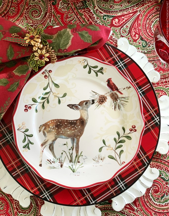 Christmas table with deer and cardinal plate | ©homeiswheretheboatis.net #Christmas #tablescapes