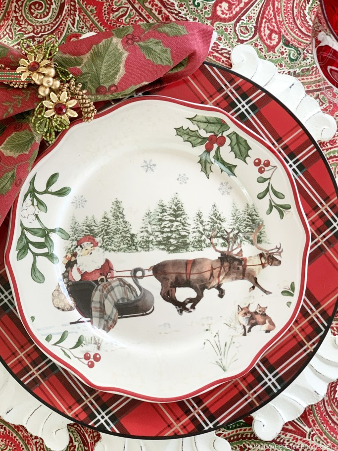 Christmas table with Santa in sleigh plate | ©homeiswheretheboatis.net #Christmas #tablescapes