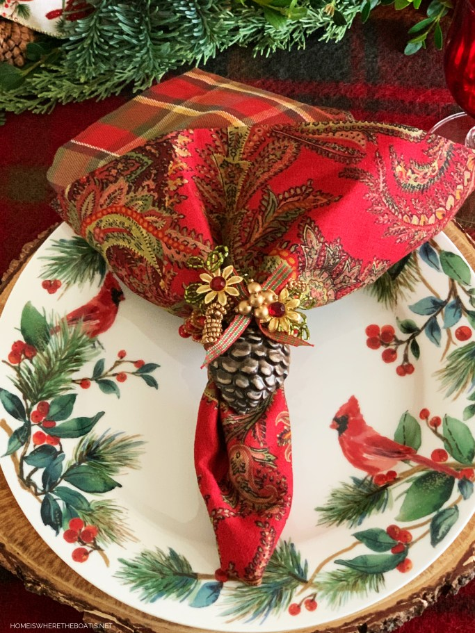 Cardinal Christmas table with Winter Cardinal plates | ©homeiswheretheboatis.net #Christmas #tablescapes #birds #tartan #plaid