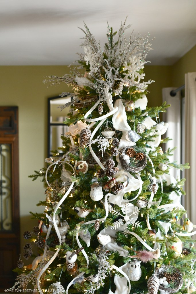 A Winter Nesting Tree for January with snowflakes, icy branches, birds and pine cones   ©homeiswheretheboatis.net