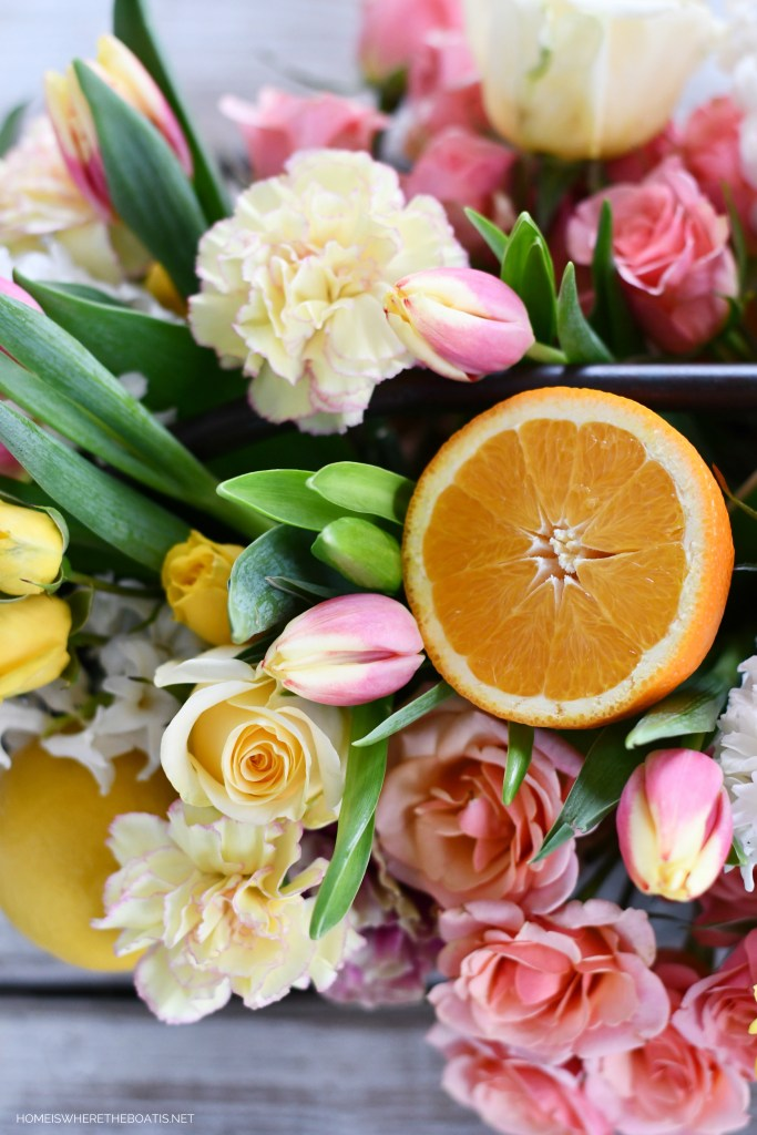 DIY Floral Arrangement with Tulips, Roses, Carnations and Citrus | ©homeiswheretheboatis.net #flowers #centerpiece #DIY