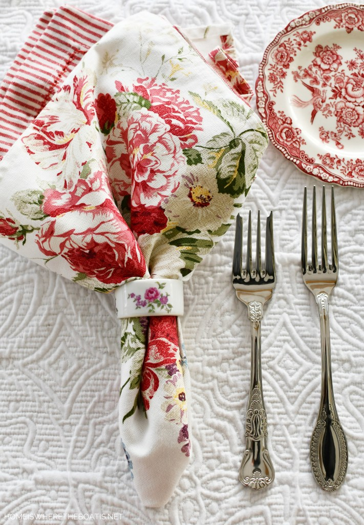 Floral napkins and red ticking stripe with pink transferware | ©homeiswheretheboatis.net #tablescapes