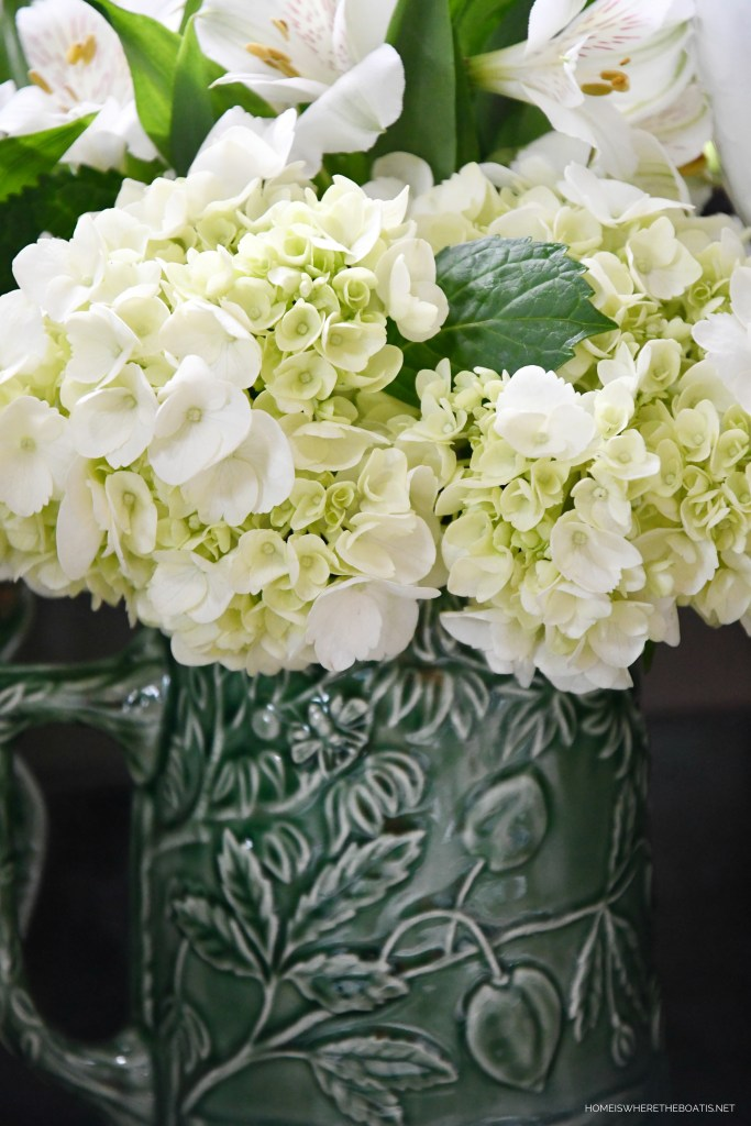 Hydrangeas in pitcher with bee | ©homeiswheretheboatis.net #bees #tablescapes #spring #green
