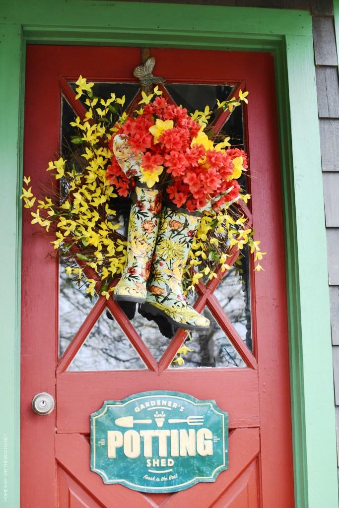 DIY Spring Wreath with blooming wellies for Potting Shed door | ©homeiswheretheboatis.net #spring #wreath #diy #flowers