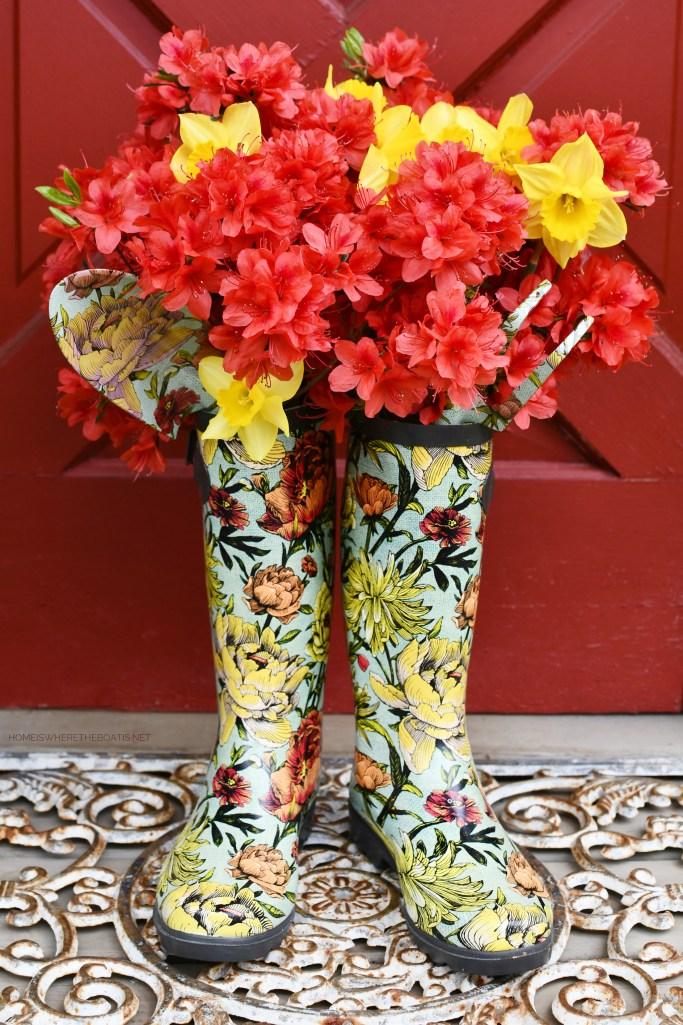 Blooming Wellies as vases with azaleas, daffodils, garden tools | ©homeiswheretheboatis.net #flowers #wellies