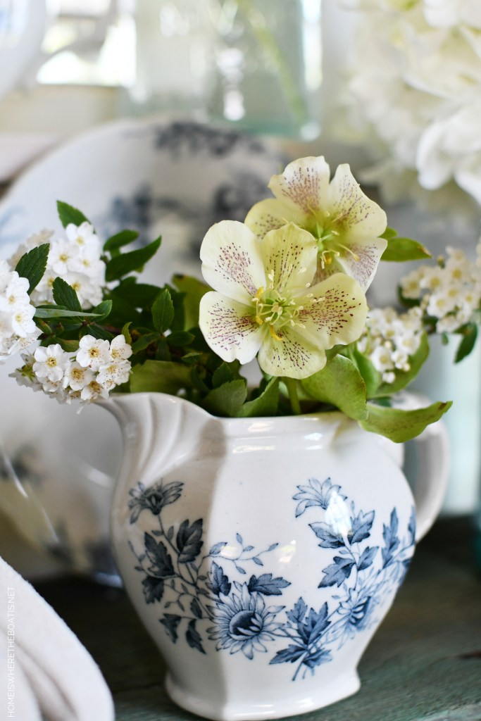 White spring blooms and blue and white transferware | ©homeiswheretheboatis.net #flowers #spring