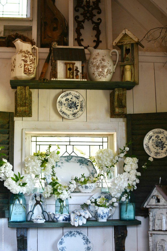 White spring blooms, mason jars and blue and white transferware in Potting Shed | ©homeiswheretheboatis.net #flowers #spring #masonjars
