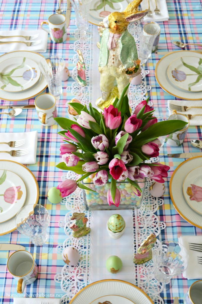 Easter table with bunnies, eggs, and tulips in jelly bean vase centerpiece! | ©homeiswheretheboatis.net #tablescapes #easter #tulips #spring