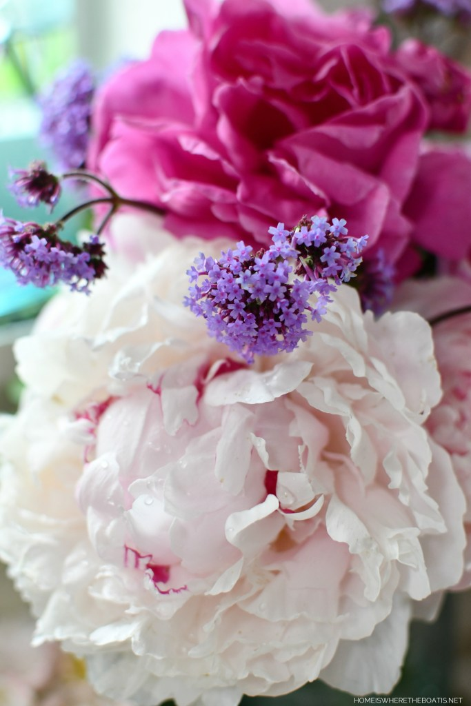 Ball jar bouquets of peonies in the Potting Shed | ©homeiswheretheboatis.net #flowers #masonjars