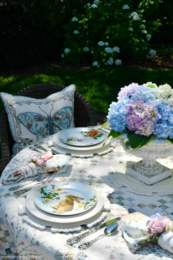Garden table with Hydrangeas, Butterflies, Bunnies and Birds| ©homeiswheretheboatis.net #alfresco #garden #spring #hydrangeas #tablescapes