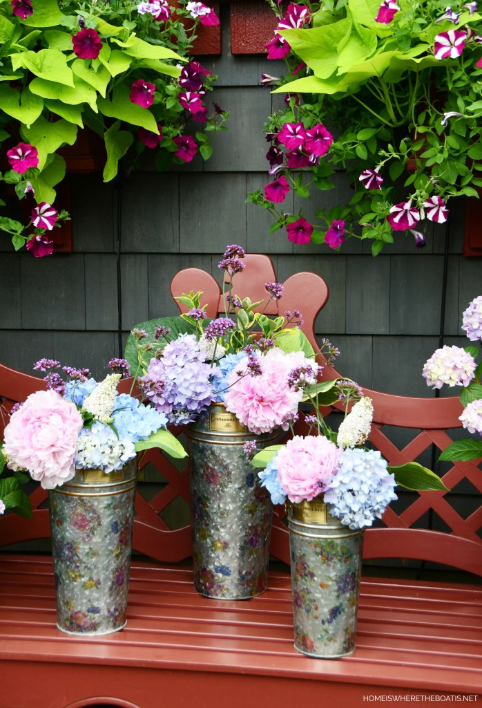 Flower market buckets of garden blooms by the Potting Shed | ©homeiswheretheboatis.net #flowers #garden #hydrangeas #windowboxes