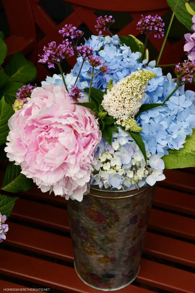 MacKenzie-Childs Flower Market Bucket with hydrangeas, peony, verbena, buddleia | ©homeiswheretheboatis.net #flowers #garden #peony #hydrangeas