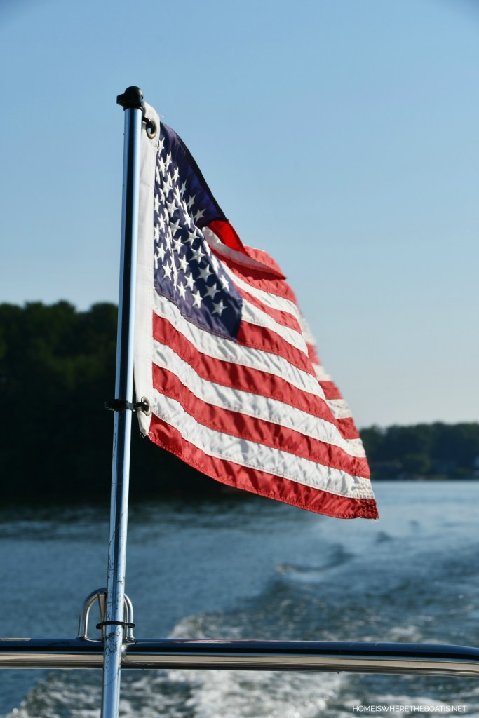 Flag on pontoon | ©homeiswheretheboatis.net #flag #lake #pontoon
