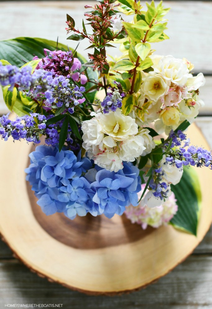 Ball jar bouquet of garden flowers | ©homeiswheretheboatis.net #jars #flowers