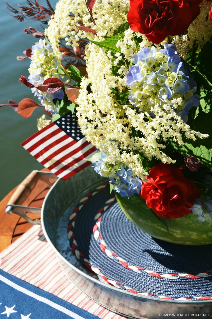 Watermelon vase centerpiece DIY | ©homeiswheretheboatis.net #patriotic #july4th #watermelon #recipes