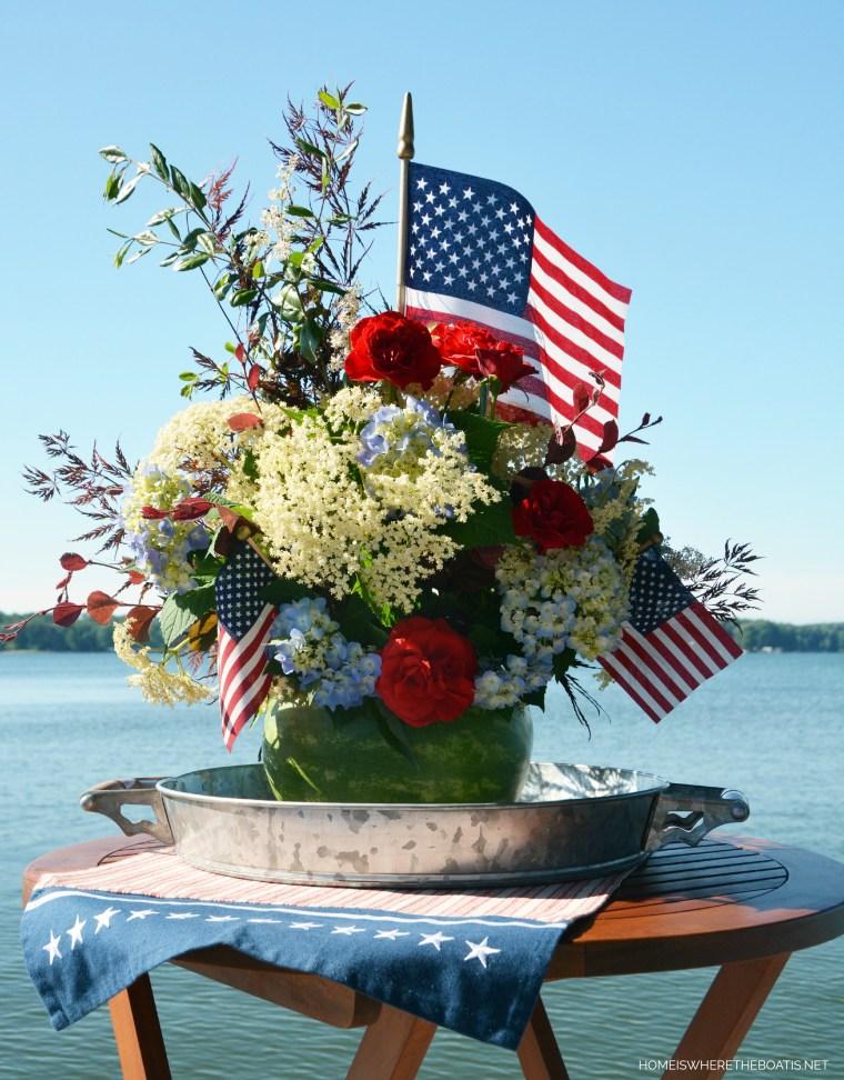 Watermelon vase centerpiece DIY | ©homeiswheretheboatis.net #patriotic #july4th #watermelon #recipes #flag