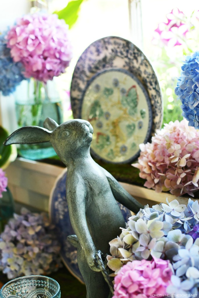 Bunnies and hydrangeas tabletop fun in Potting Shed | ©homeiswheretheboatis.net #hydrangeas #flowers #garden #tablescapes