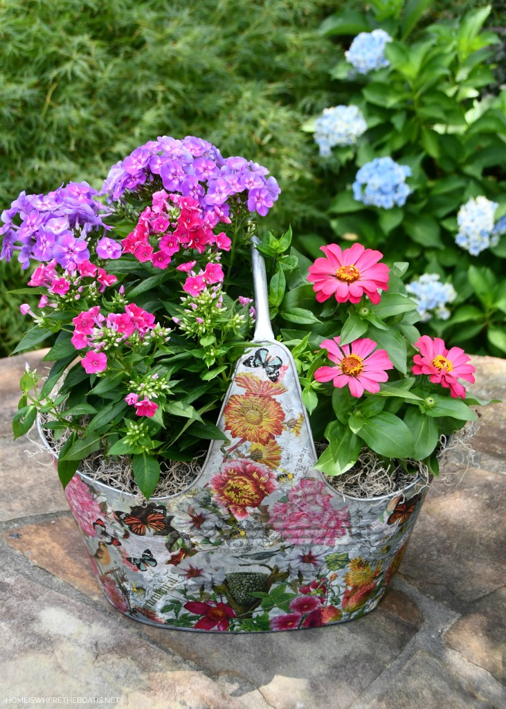 Decoupaged galvanized tub as a planter | ©homeiswheretheboatis.net #DIY #craft