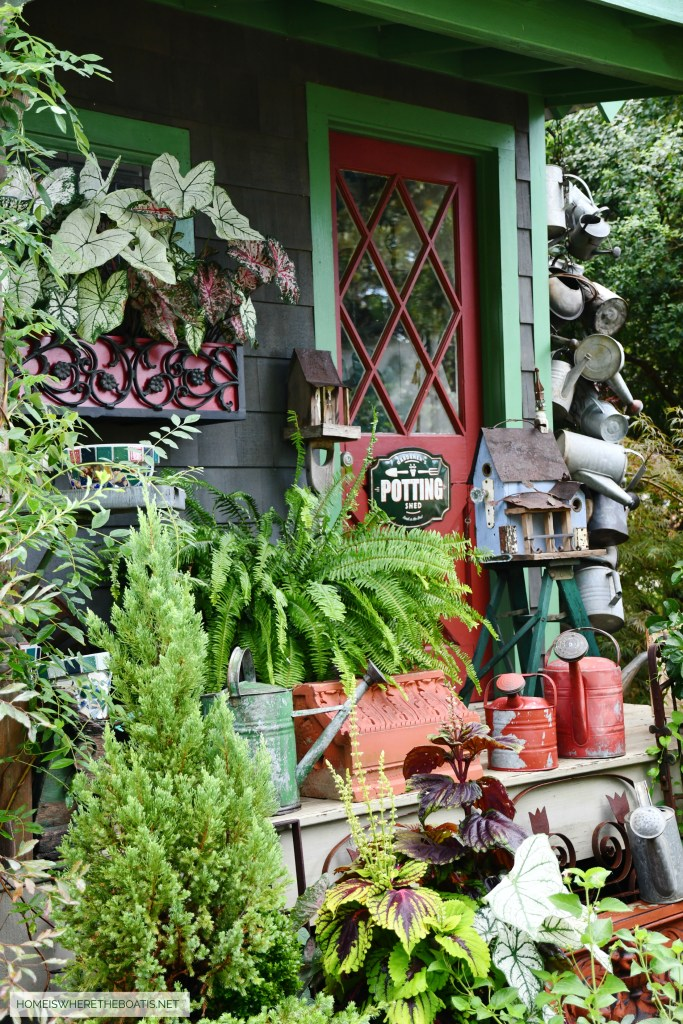 Birdhouse on porch of Potting Shed | ©homeiswheretheboatis.net #diy #repurpose #craft #birdhouse #garden #flowers #shed