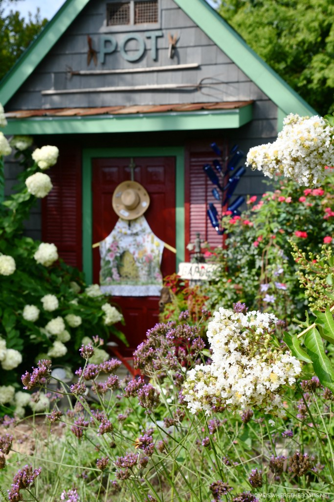Summer Potting Shed Door with Bee Apron and Hat | ©homeiswheretheboatis.net #bees #flowers #garden #shed