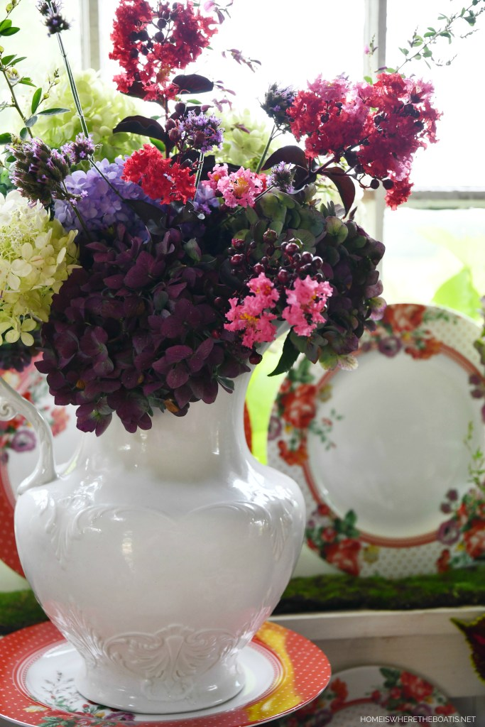 Garden Bouquet in ironstone pitcher with floral dinnerware | ©homeiswheretheboatis.net #tablescapes #redandwhite #flowers