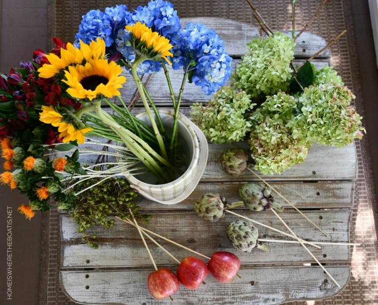 DIY transitional flower arrangement | ©homeiswheretheboatis.net #hydrangeas #sunflowers