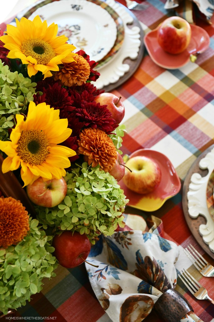 Falling for Apples Tablescape and Flower Centerpiece with Apples, Sunflowers and Hydrangeas | ©homeiswheretheboatis.net #apple #fall #tablescapes #sunflowers