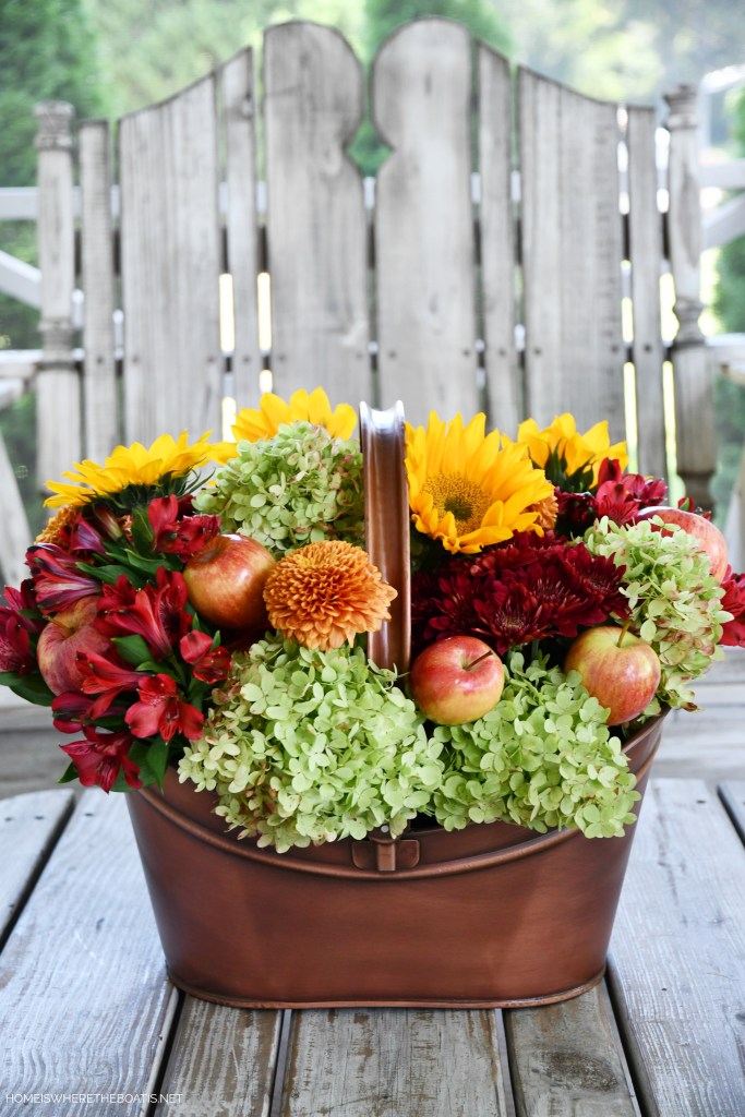 DIY 'Falling for Apples' Flower Arrangement with Sunflowers and Transitional Fall Table | ©homeiswheretheboatis.net #fall #tablescapes #apples #plaid #sunflowers