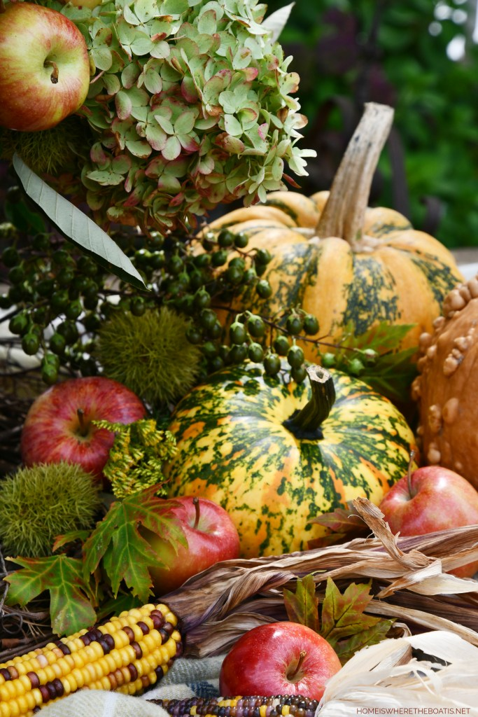 Autumn Harvest Arrangement | ©homeiswheretheboatis.net #fall #hydrangeas #apples #pumpkins #centerpiece