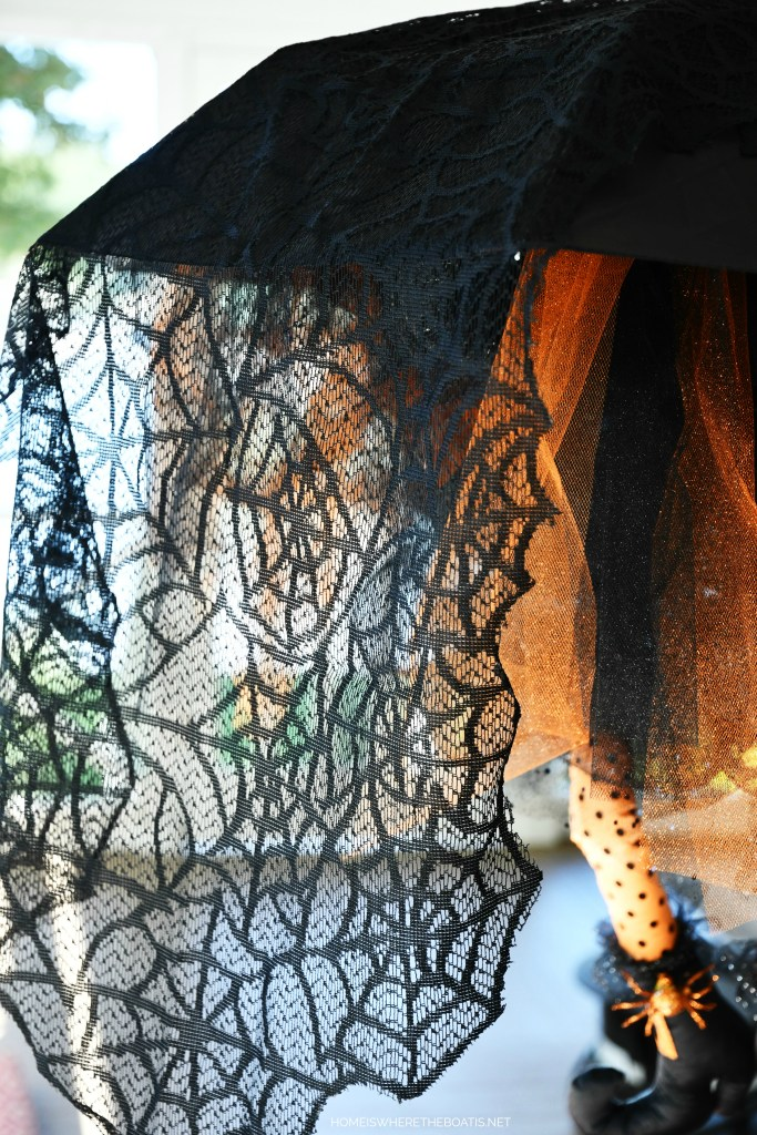 Use an umbrella from the dollar store to create a floating witch for Halloween! | ©homeiswheretheboatis.net #Halloween #witch #DIY