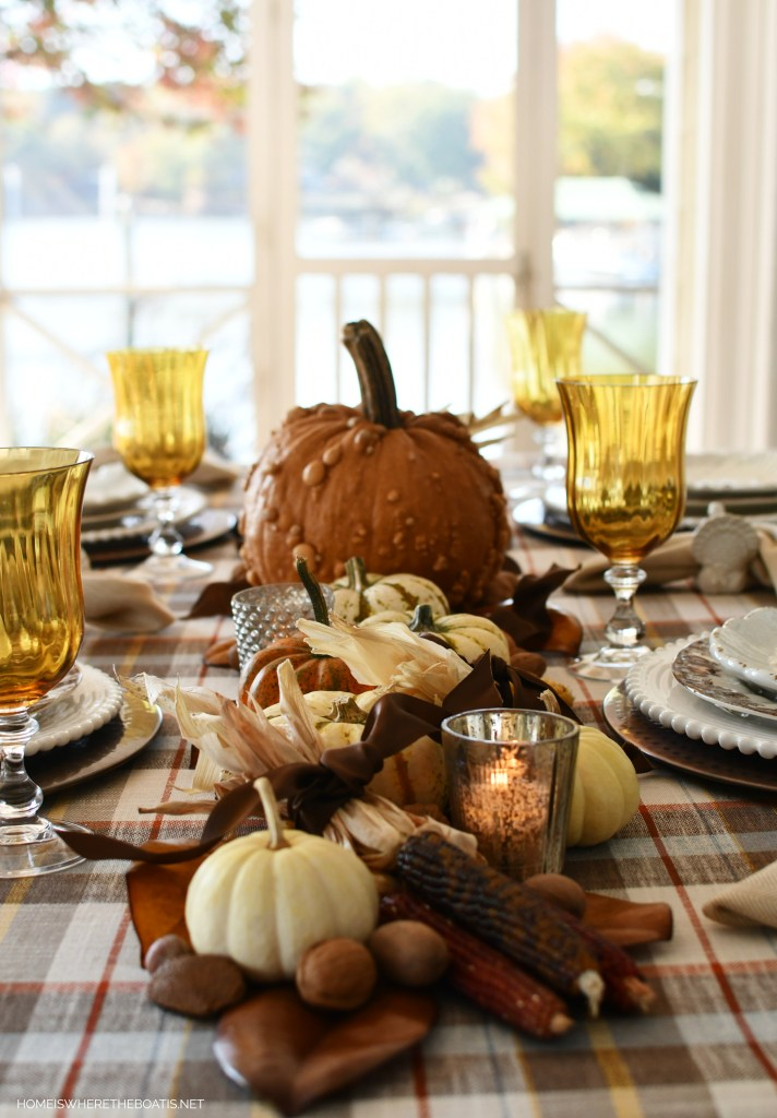 DIY harvest runner with pumpkins, nuts, leaves and Indian corn for Thanksgiving | ©homeiswheretheboatis.net #thanksgiving #tablescapes #DIY
