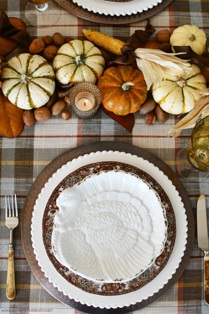 Thanksgiving table with plaid, natural runner and turkey plates | ©homeiswheretheboatis.net #thanksgiving #tablescapes #DIY