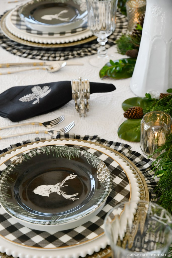 Christmas tablescape withdeer plates and black and white checks | ©homeiswheretheboatis.net #christmas #tablescapes
