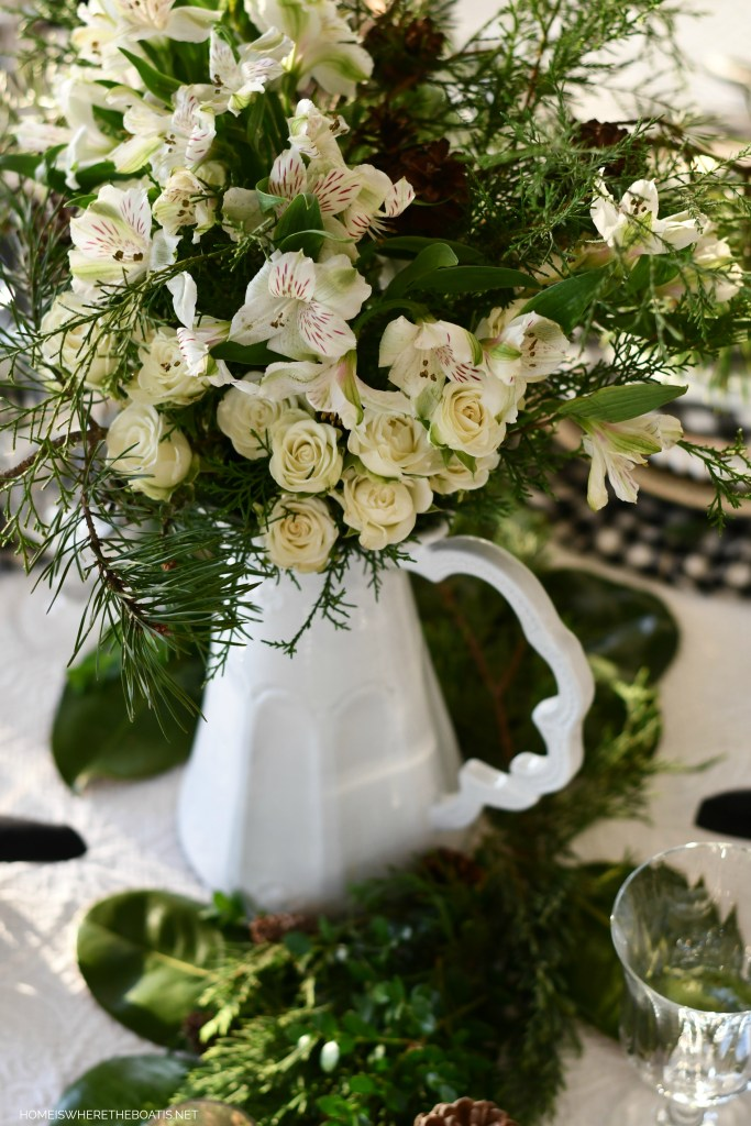 Christmas tablescape with Arte Italica pitcher and black and white checks | ©homeiswheretheboatis.net #christmas #tablescape