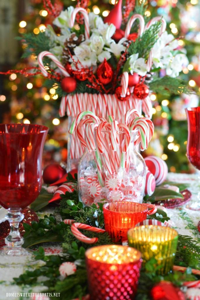 Candy Cane Christmas table Centerpiece DIY | ©homeiswheretheboatis.net #Christmas #tablescape #redandgreen #candycanes