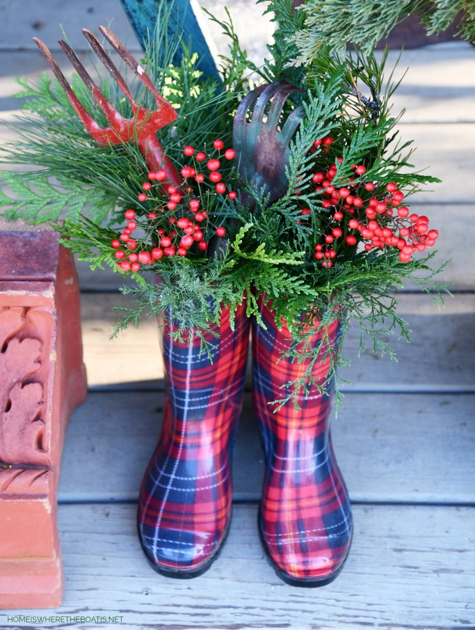 Plaid wellies with vintage garden tools, greenery and berries | ©homeiswheretheboatis.net #shed #christmas #greenery