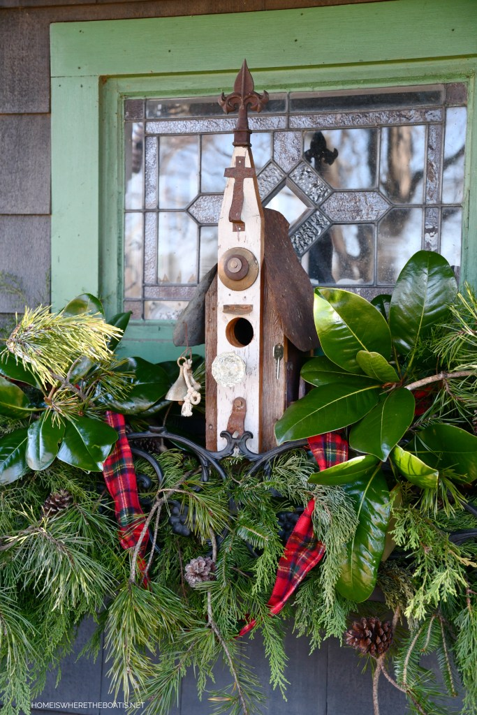 Birdhouse in window box with greenery for Christmas | ©homeiswheretheboatis.net #shed #christmas #greenery