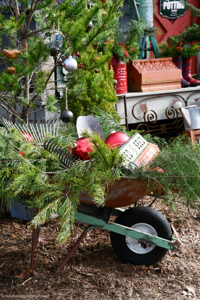 Wheelbarrow the old garden tools, greenery and ornaments for Christmas the Potting Shed | ©homeiswheretheboatis.net #shed #christmas #greenery #garden