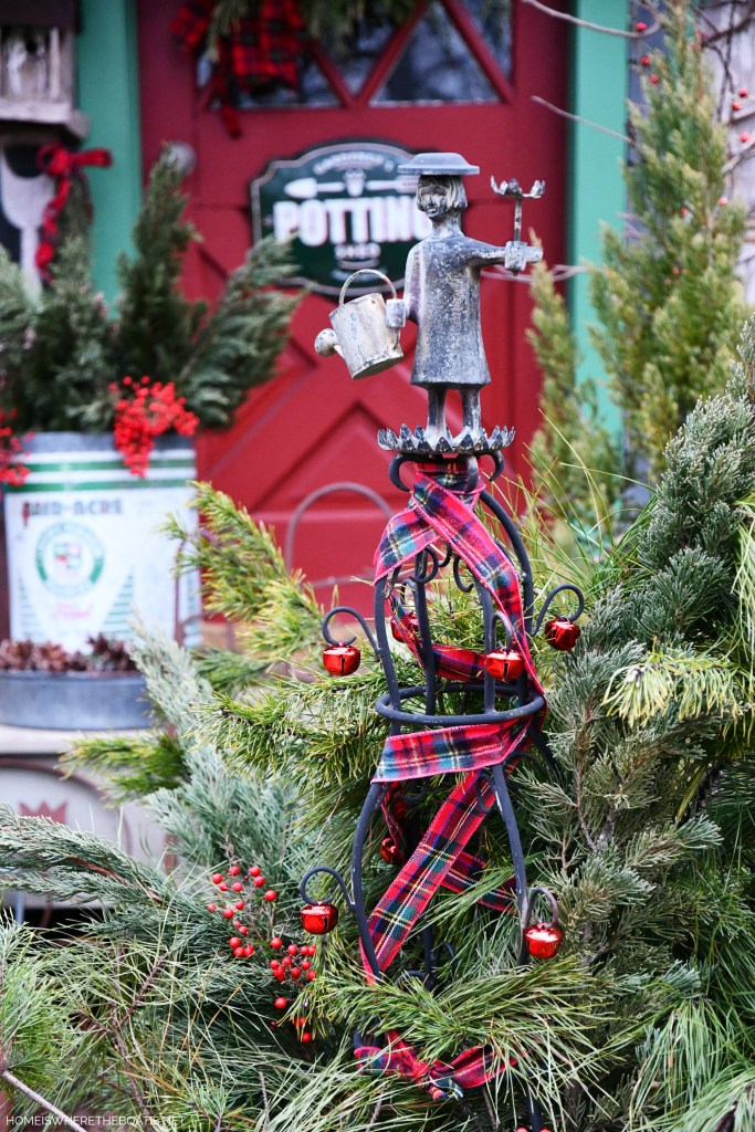 Mrs. Powers Tuteur with tartan ribbon and jingle bells by Potting Shed for Christmas | ©homeiswheretheboatis.net #pottingshed #christmas #greenery #garden