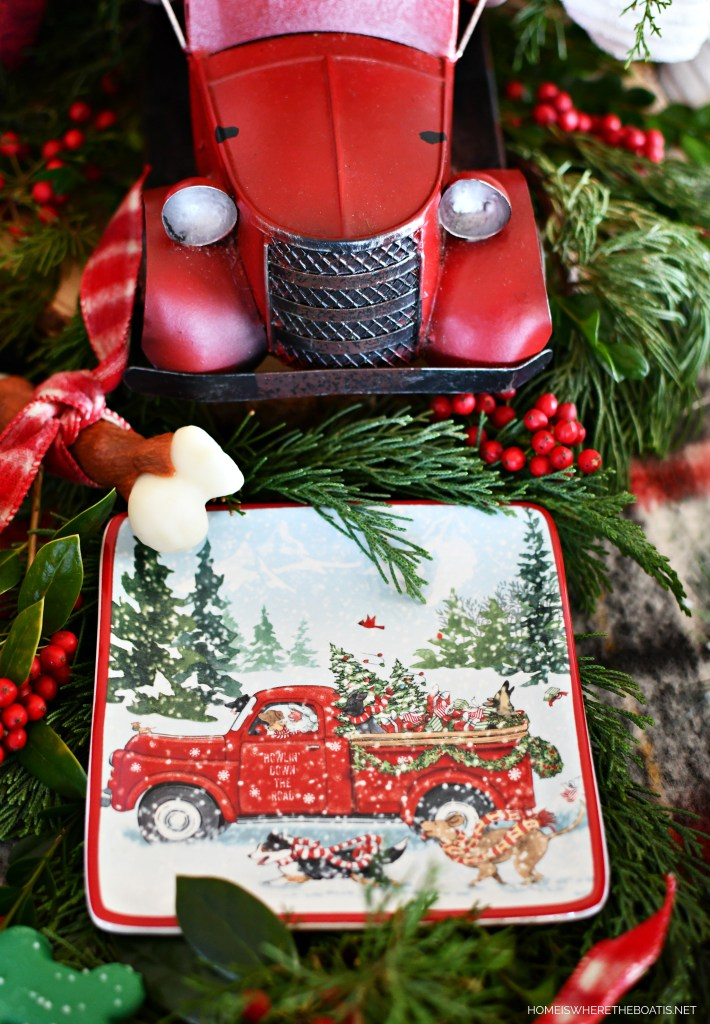 Whimsical 'Hauliday Dawgs' Toys and Treats Table with Red Truck | ©homeiswheretheboatis.net #christmas #table #redtruck #dogs
