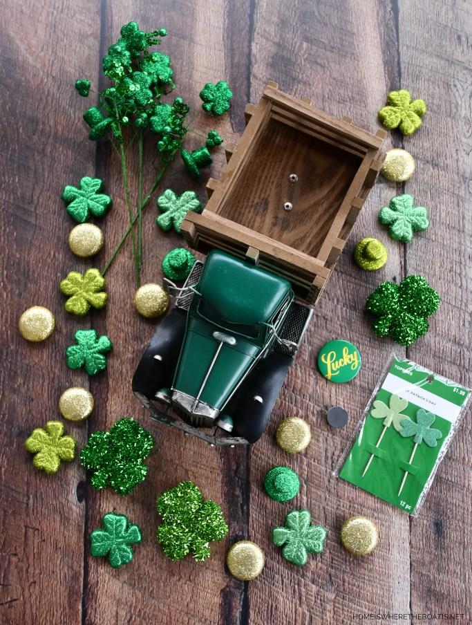 St. Patrick's Day centerpiece with truck delivering shamrocks | ©homeiswheretheboatis.net #stpatricksday #tablescapes