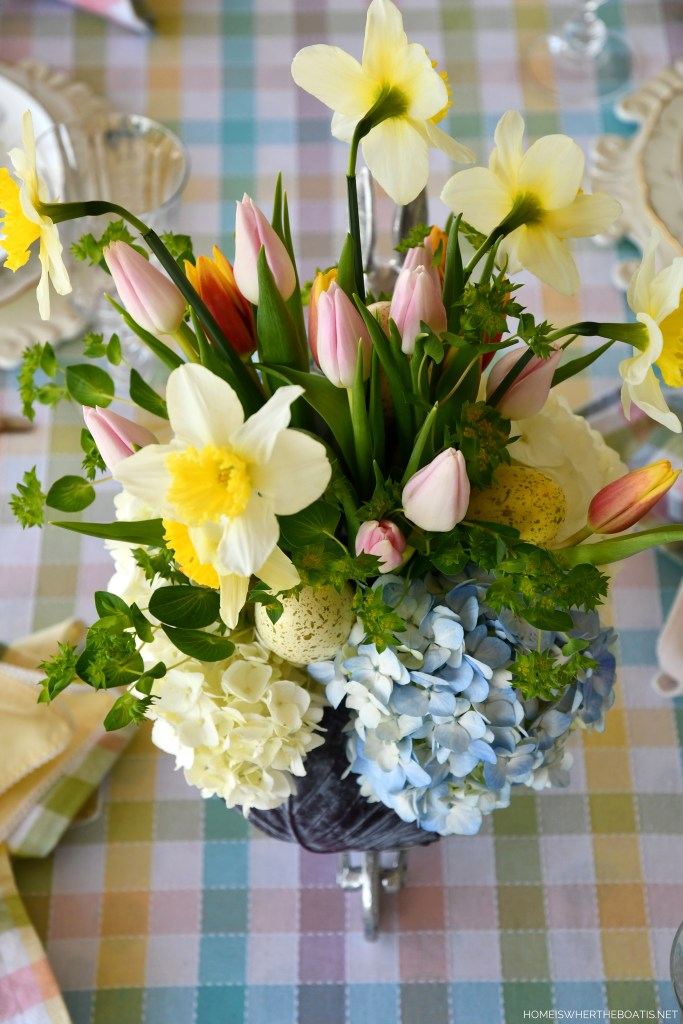 DIY Blooming Cabbage Arrangement with daffodils, tulips, hydrangeas | ©homeiswheretheboatis.net #DIY #easter #spring #flowers #tablescape