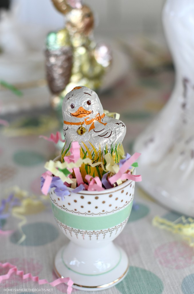 Lindt mini chocolate chick in egg cup for Easter | ©homeiswheretheboatis.net #easter #tablescapes #bunny