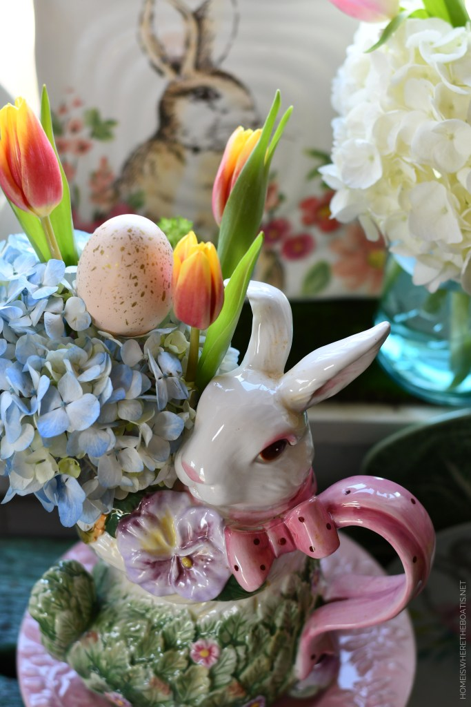 Bunny pitcher with hydrangeas, tulips, egg | ©homeiswheretheboatis.net #spring #easter #tablescape #rabbits #flowers
