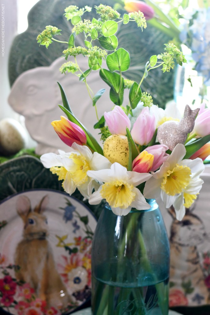 Ball jar bouquet of spring flowers, bunny pick and Easter egg | ©homeiswheretheboatis.net #spring #easter #tablescape #flowers #rabbits #masonjar