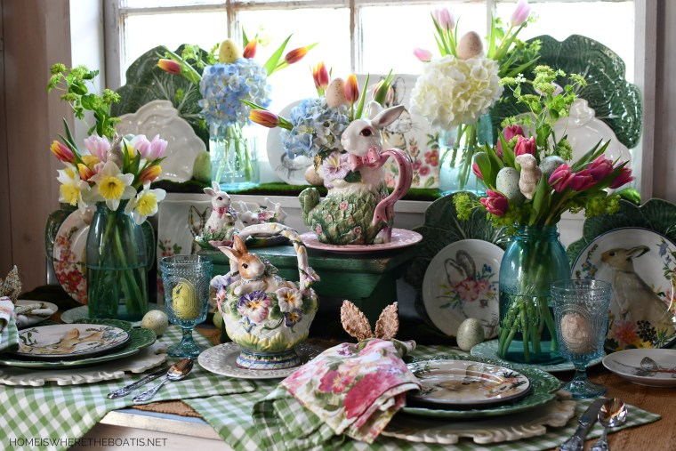 Spring tablescape with bunnies in Potting Shed | ©homeiswheretheboatis.net #spring #easter #tablescape #rabbits