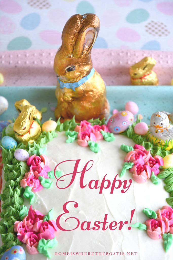 Cake with chocolate bunnies, chicks and candy for Easter | ©homeiswheretheboatis.net #easter #dessert #cake #recipe