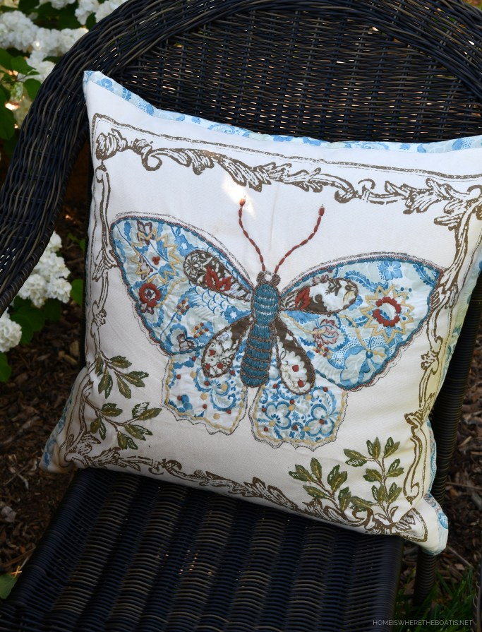Embroidered pillow with butterfly | ©homeiswheretheboatis.net #spring #flowers #garden #tablescape #alfresco