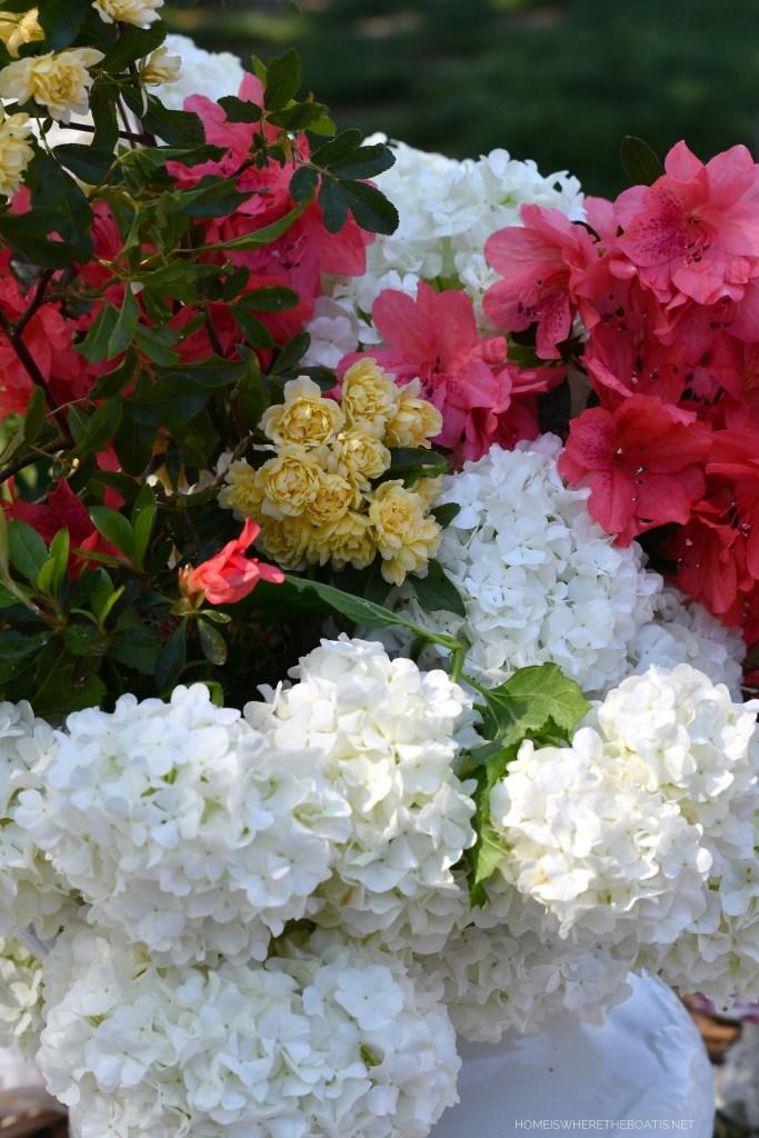 Spring garden flower arrangement of viburnum, azaleas, Lady Banks rose | ©homeiswheretheboatis.net #spring #tablescape #alfresco #lake